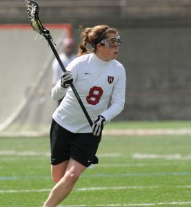Melanie Baskind, a 2008 graduate of Framingham High School, is playing lacrosse for Harvard University this spring after helping the women's soccer team repeat as Ivy League champs this fall.