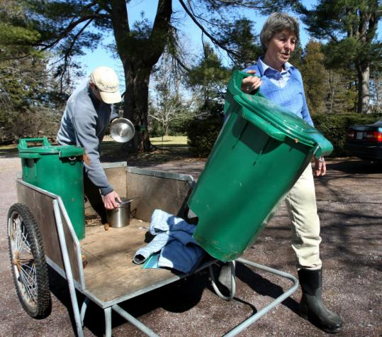 Mitchell Clark-Goldfeld (left) helps his mother, recycling advocate Gretel Clark, with their home composting in H