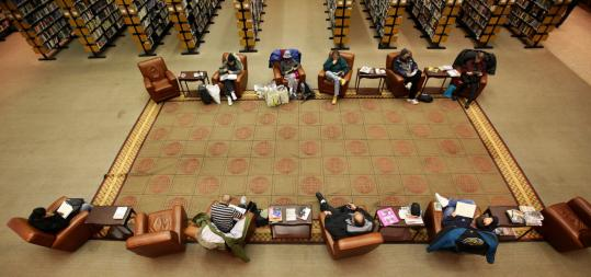 The Boston Public Library main branch in Copley Square is not in danger of closing, but several smaller branches could face the budget's ax. Other options include keeping all branches open, but drastically cutting their hours of operation.