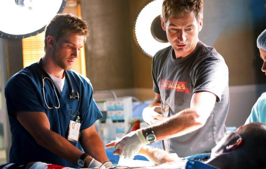 """Mike Vogel (left) and Jeremy Northam play doctors on """"Miami Medical,'' CBS's new Friday night series."""