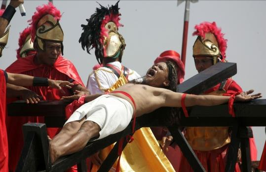 As his way of thanking God for surviving a fall from a building, 49-year-old sign painter Ruben Enaje was nailed to a cross for the 24th time during a ritual rejected by church leaders.