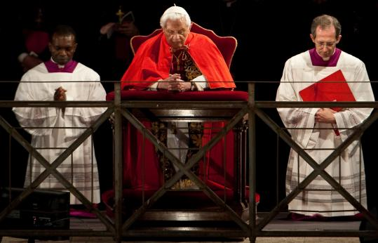 Pope Benedict XVI prayed during a Good Friday service outside the Colosseum yesterday in Rome.