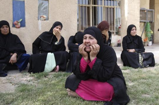 Women reacted to the killing of relatives at one of the houses in Baghdad that was attacked yesterday. The bloodshed occurred amid increasing concerns that insurgents will take advantage of Iraq's political turmoil to further destabilize the country.