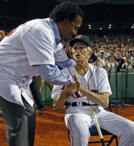 Pedro Martinez received a warm greeting from 90-year-old Red Sox legend Johnny Pesky after throwing out the first pitch.