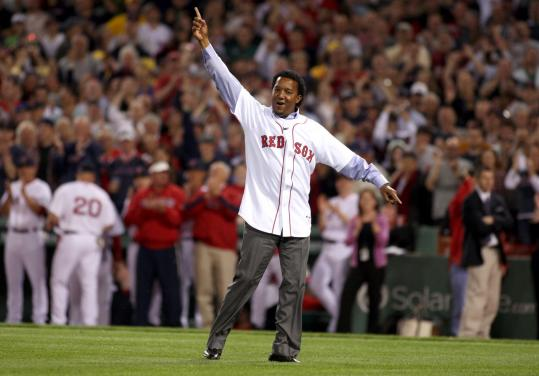 Former Red Sox ace Pedro Martinez greeted the Fenway Park crowd after throwing out the first pitch. Coverage, C1.