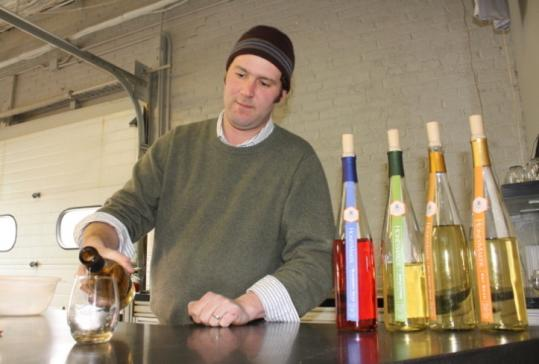 "Ben Alexander pours a glass of ""mankind's oldest drink'' during a tasting at Maine Mead Works, which also offers tours."