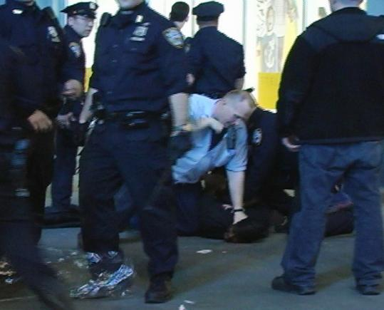 "In this image taken from video,  New York police detained people involved in a melee near Times Square.  Mayor Michael Bloomberg described the night's events as ""wilding.''"
