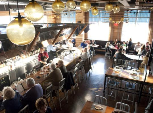 Legal C Bar in Legacy Place in Dedham offers a modern, open floor plan. It naturally features a nice assortment of raw offerings, such as the shellfish tower platter.