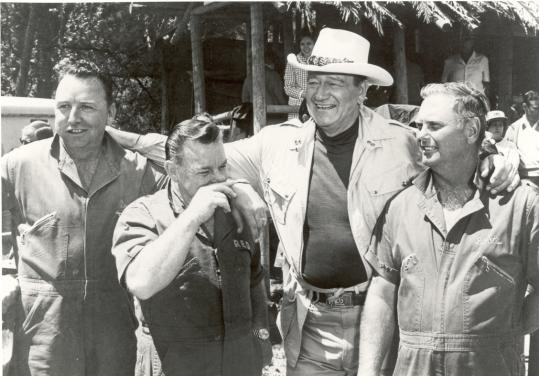 "From left, Mr. Matthews, Red Adair, John Wayne, and Boots Hansen on the set of ""Hellfighters.'' In 1962, the firefighters put out one of the most famous oil well fires in history, in Algeria."