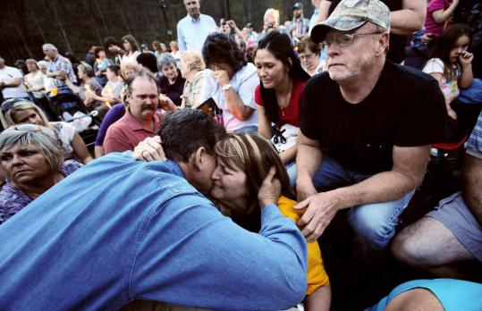 At a candlelight vigil yesterday, West Virginia Governor Joe Manchin hugged Pam Napper, whose son Josh was one of the 25 miners killed in a coal mine explosion Monday. The Nappers also lost two other family members in the blast.