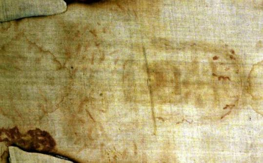 The Shroud of Turin, a 14-foot-long linen revered by some as the burial cloth of Jesus, draws believers and the curious.