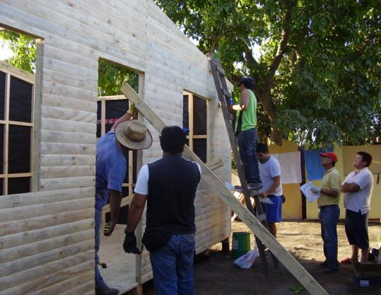 Volunteers in Curico, Chile, built emergency dwelling for victims of the Feb. 27 earthquake.