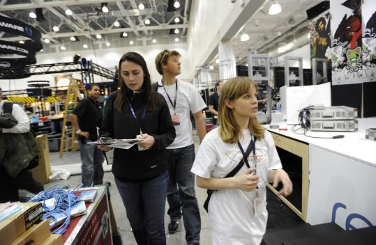 Kate Reynolds (left), Laura Rapalski, and Chris Zegel of Scvngr inspected PAX East vendor booths.