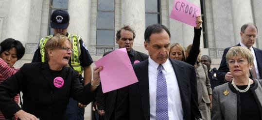 Protesters heckle Lehman Brothers chief executive Dick Fuld after he testified before a House committee on Oct. 6, 2008.