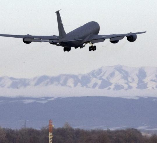 A US Air Force plane takes off from Manas air base, used to supply troops, in Kyrgyzstan.