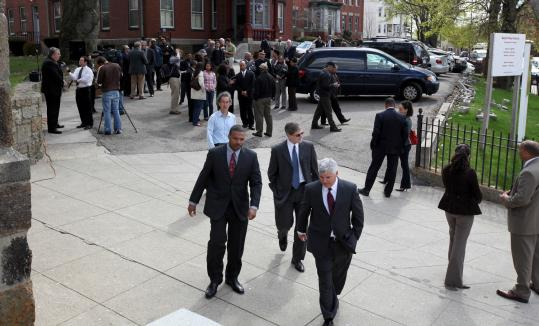 Suffolk District Attorney Daniel F. Conley (center) and Boston Police Commissioner Edward F. Davis, being interviewed at left, were speakers at St. Peter's Church in Dorchester, where a Community Partnership for Peace and Justice was announced.