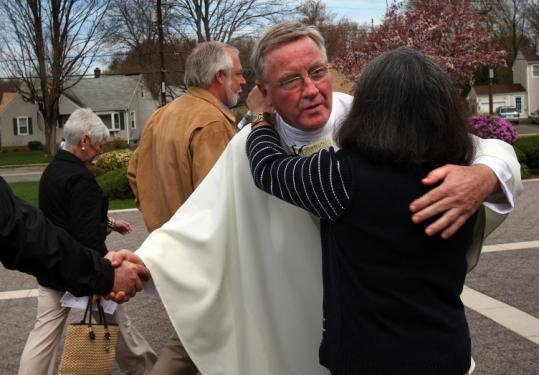 The Rev. James J. Scahill greeted people after Sunday's Mass.
