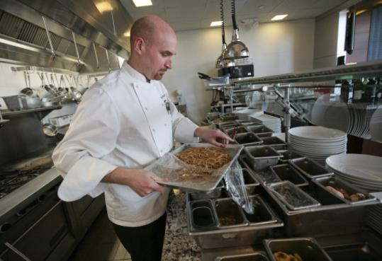 Executive chef Gregory Griffie prepares whole-wheat spaghetti with broccoli rabe and turkey sausage at 606 Congress.
