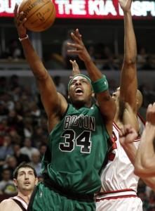 With the Bulls' Taj Gibson (right) lurking around, Celtic captain Paul Pierce stretches to keep the ball out of harm's during a second-half drive.