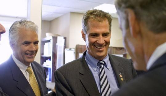 From left, Senators John Ensign, Republican from Nevada, Scott Brown of Massachusetts, and Tom Carper, a Democrat from Delaware, chatted on Capitol Hill yesterday.