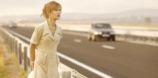 Isabelle Huppert plays the mother of a family living by an unfinished highway.