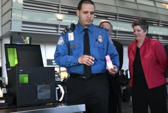 Janet Napolitano, secretary of Homeland Security, watched Jefferson Morales demonstrate the device yesterday at Logan.