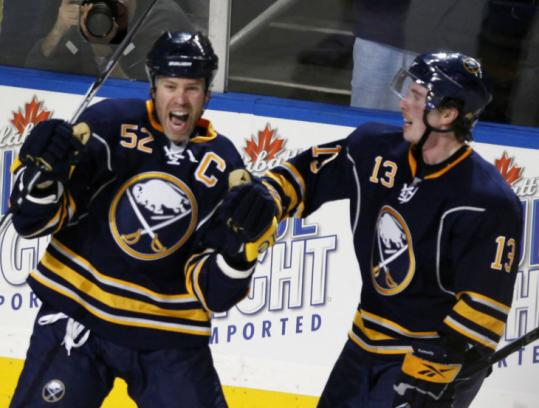 Buffalo's Craig Rivet (left) has reason to be excited after scoring only the fourth playoff goal of his 15-year career.