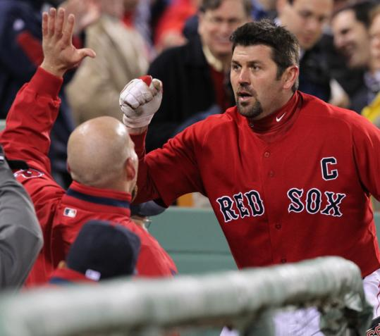 His teammates had to hand it to Jason Varitek after he hit his third home run of the season.