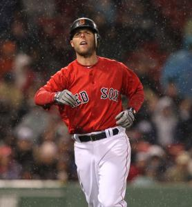 Red Sox second baseman Dustin Pedroia lined to short in the eighth inning of a 1-1 game as the rain began to get heavy at Fenway Park last night.