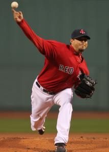 Josh Beckett baffled the Rays over seven innings, allowing only an unearned run on four hits.