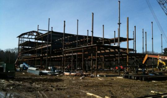 Construction continues on the new Hanover High School as a court considers a lawsuit involving the contractor.