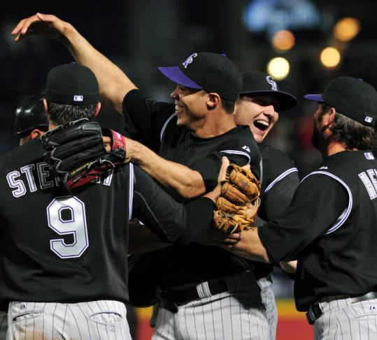 It's party time for Ubaldo Jimenez (center) and his Rockies teammates at Turner Field after he no-hit the Braves.