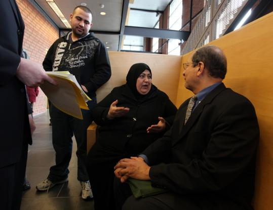 Awatif Albadri and her son, Anas Alhamdani (left), spoke with interpreter Bashier Doss in Chelsea District Court last month concerning her family's efforts to avoid being evicted.