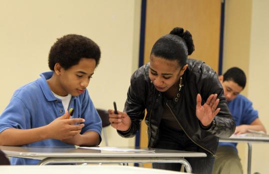 Thomas Pepenh worked with group leader Yeliza Cardoso during homework club at Lilla Frederick Pilot Middle School last week.