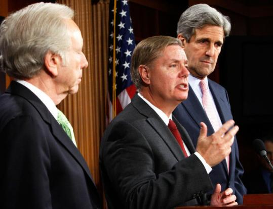 Republican Senator Lindsey Graham speaks at a news conference outlining a bipartisan climate and energy proposal while Democratic Senators Joseph Lieberman, left, and John Kerry look on. Getty Images