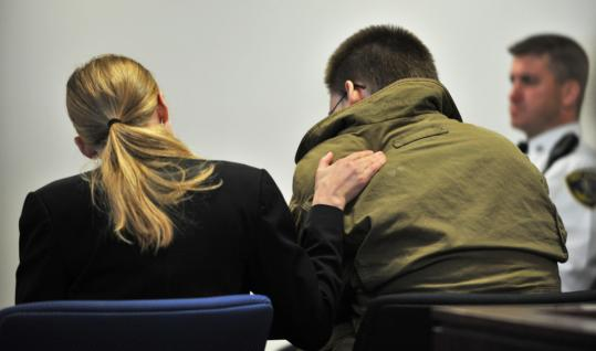 Legal associate Amanda Vanderhorst comforted John Odgren, who put on a coat over his suit during proceedings at his murder trial yesterday in Woburn. Odgren faces life in prison, but his lawyers argue that he is not guilty by reason of insanity.