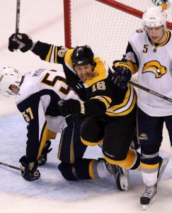Marco Sturm split two Sabres en route to celebrating Miroslav Satan's winning goal.