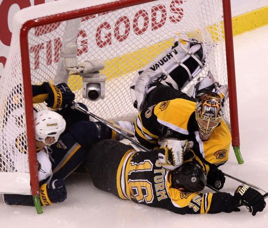 Cody McCormick gets a penalty for plowing into goalie Tuukka Rask in the third, leading to a power-play goal for the Bruins.