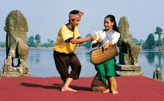 "Sy Sar  (left)  performs Khmer, a traditional dance of Cambodia, in Anne Bass's film  ""Dancing Across Borders.''"