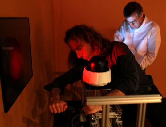 Seth Riskin (left) and Allan Doyle of the MIT Museum installed a camera for a holography gallery for the science festival.