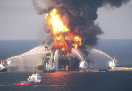 Crews battled the blazing oil platform in an image captured Wednesday but released yesterday. The rig has since sunk.