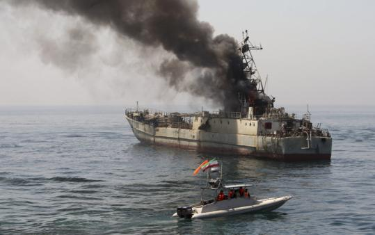 An abandoned ship, being used as a target, took fire during an exercise in Iran's Revolutionary Guard war games yesterday in the Persian Gulf. Iran has been holding military maneuvers, dubbed The Great Prophet, annually since 2006 to show off its military capabilities.