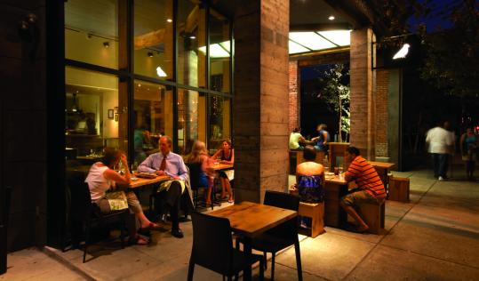 Patrons sit outside at the eco-conscious 732 Social, where the food is seasonal and sustainable. At Proof on Main, a bronze satyr sculpture perched on the bar greets visitors.