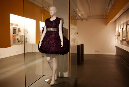 A couture cocktail dress at the Museum of Sex is made out of 1,200 dyed condoms.
