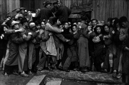Among the more than 300 photographs on display at 'Henri Cartier-Bresson: The Modern Century' at the Museum of Modern Art are 'Shanghai, China' (above).