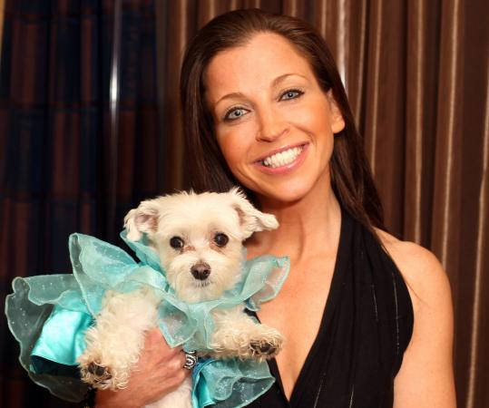 "Author Wendy Diamond, with her Maltese, Lucky. Diamond promotes a healthy lifestyle with pets, including doing ""doga,'' yoga with your dog."