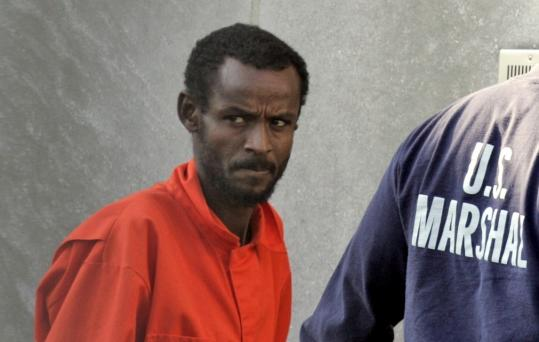 A suspected pirate from Somalia was escorted into federal court yesterday under heavy security.