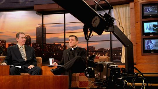 """Cohosts Kevin Nelson (left) and the Rev. Robert Reed taped the show """"This Is the Day'' at CatholicTV's Watertown studios yesterday."""
