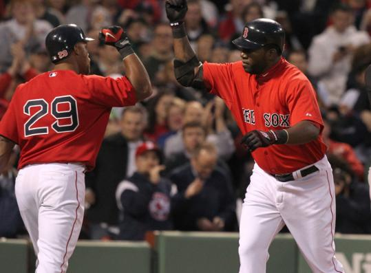 David Ortiz crosses the plate following his first homer of the season, a solo shot in the second.