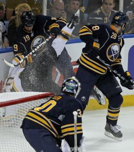 In an attempt to get a leg up on the competition, Bruins left wing Daniel Paille is instead upended by the Sabres' Tim Connolly (19) in the Buffalo zone in the first period.